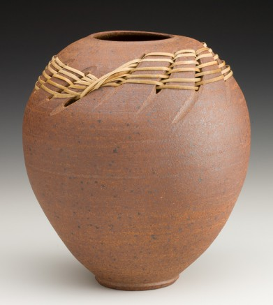 stoneware vessel with rattan